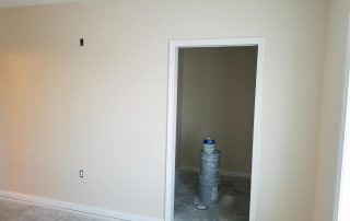 paint buckets in white room