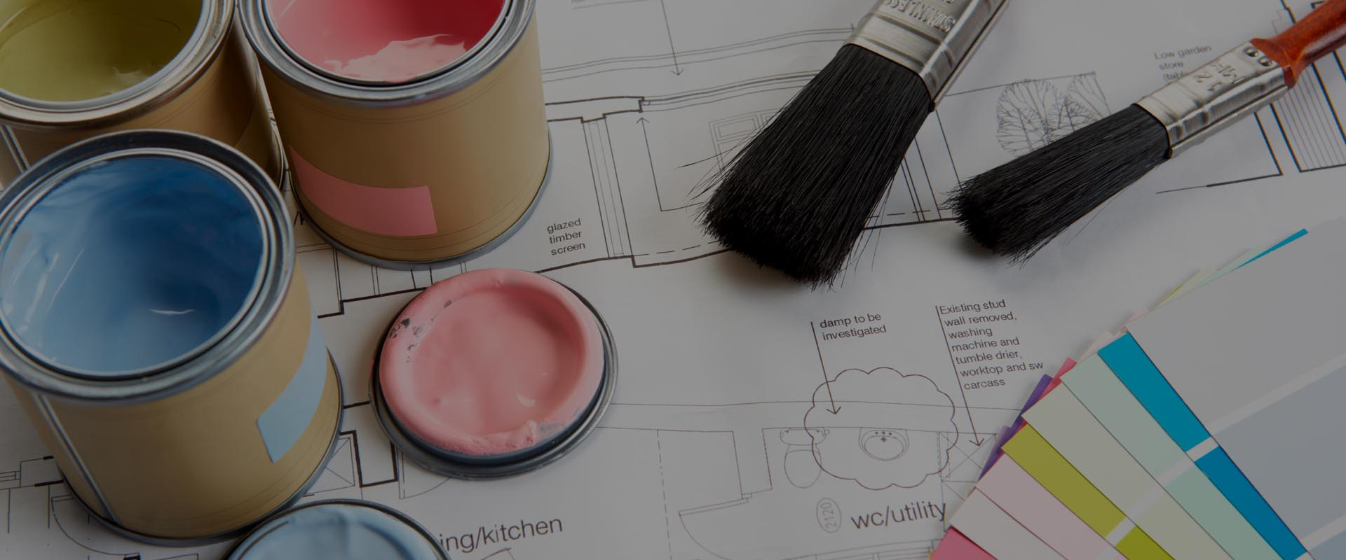 paint brushes and opened paint containers